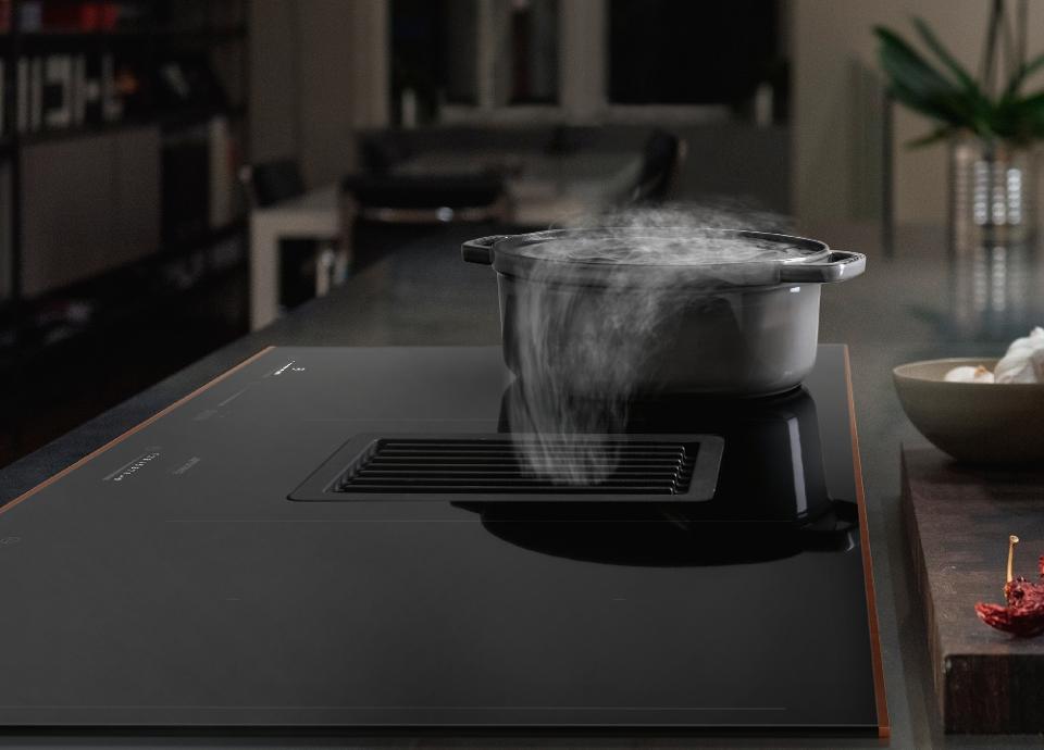 Les tables de cuisson avec hotte intégrée