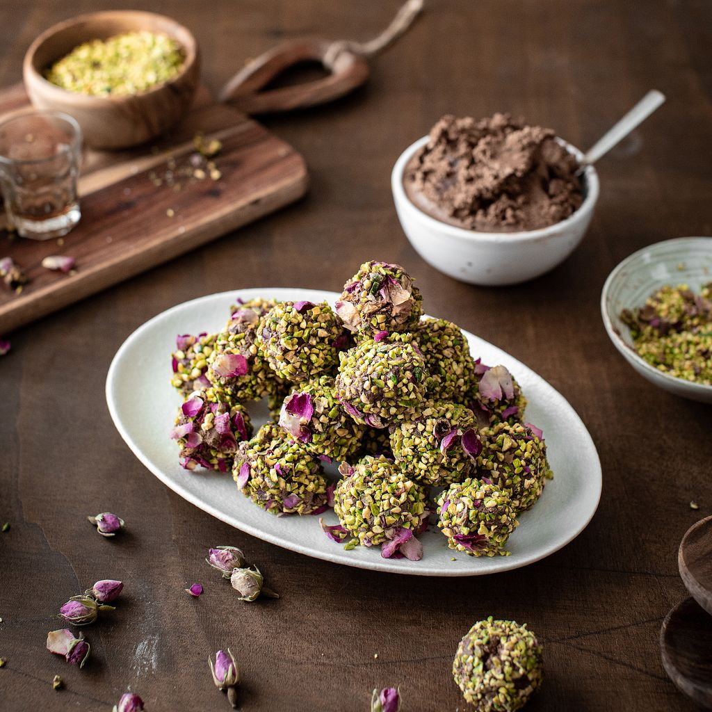 Chocolate and rum truffles, with pistachios and roses